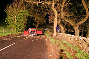 Car crashed at night on a rural road