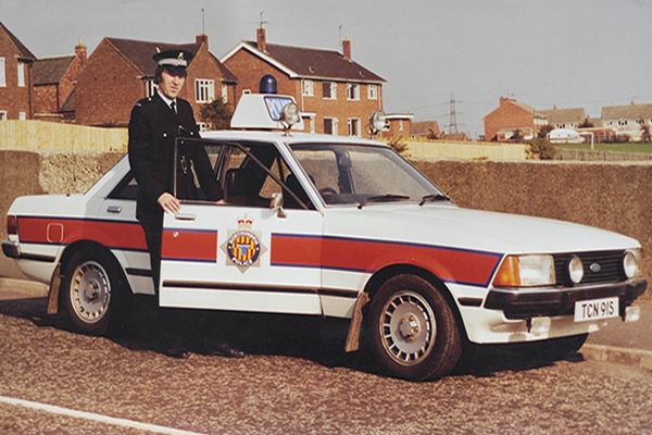 "Officer and a Ford Granada ""Jam Sandwich"""
