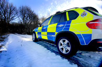 A police 4x4 vehicle in snowy conditions