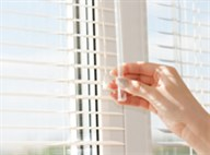 Closing window blinds.