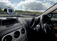 An image of a Sat Nav left in a car