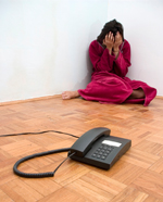 A victim of domestic abuse with a telephone