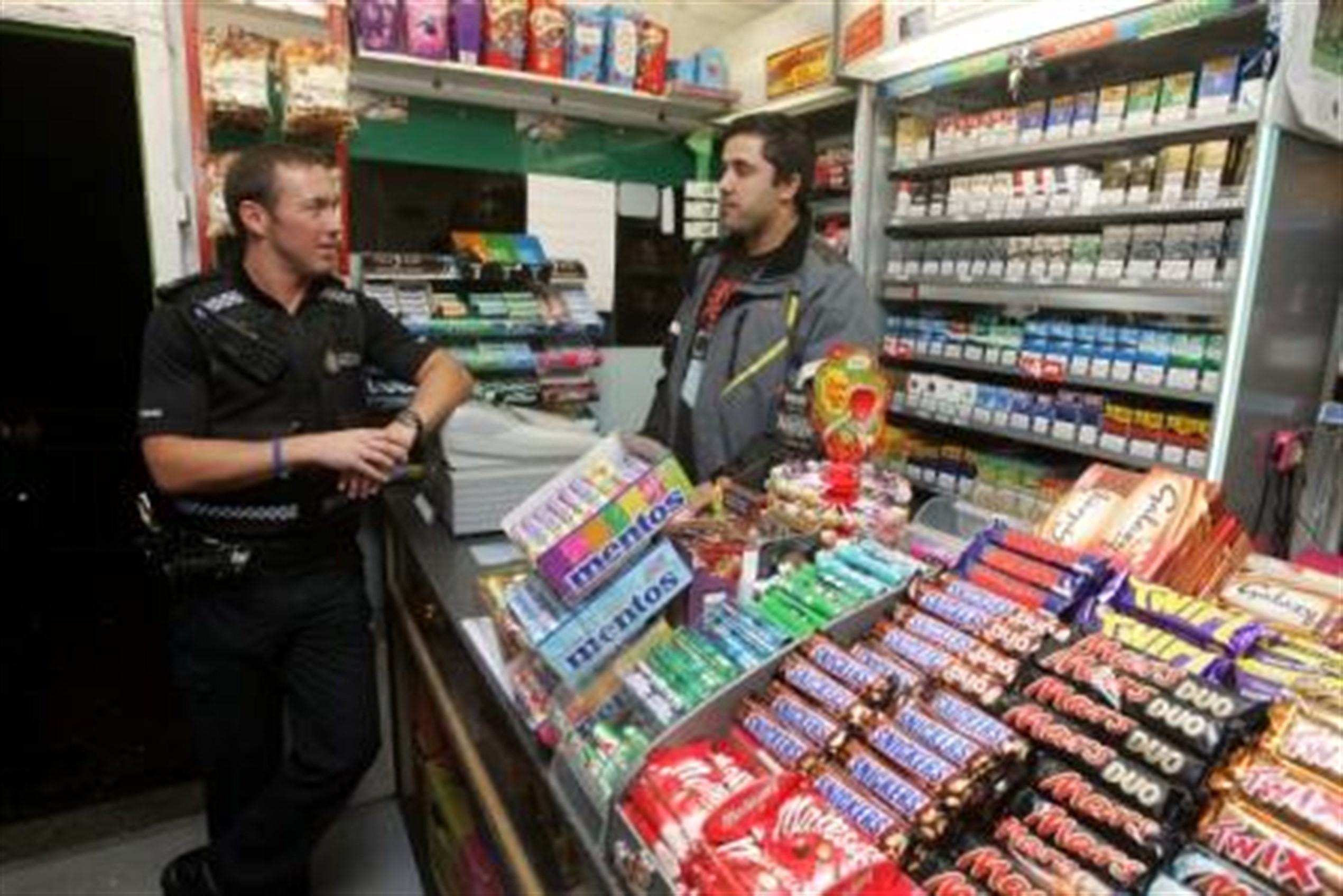 PC Graham Yare giving message to retailer about firework laws