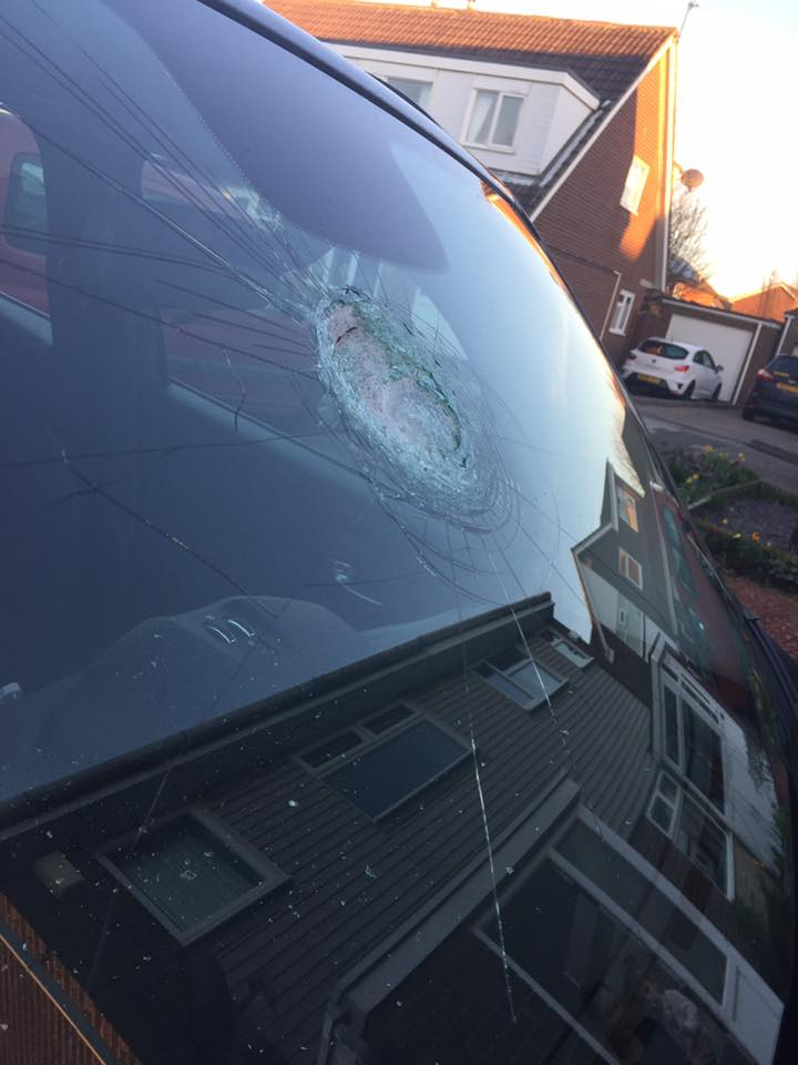 Car smashed by youths throwing bricks